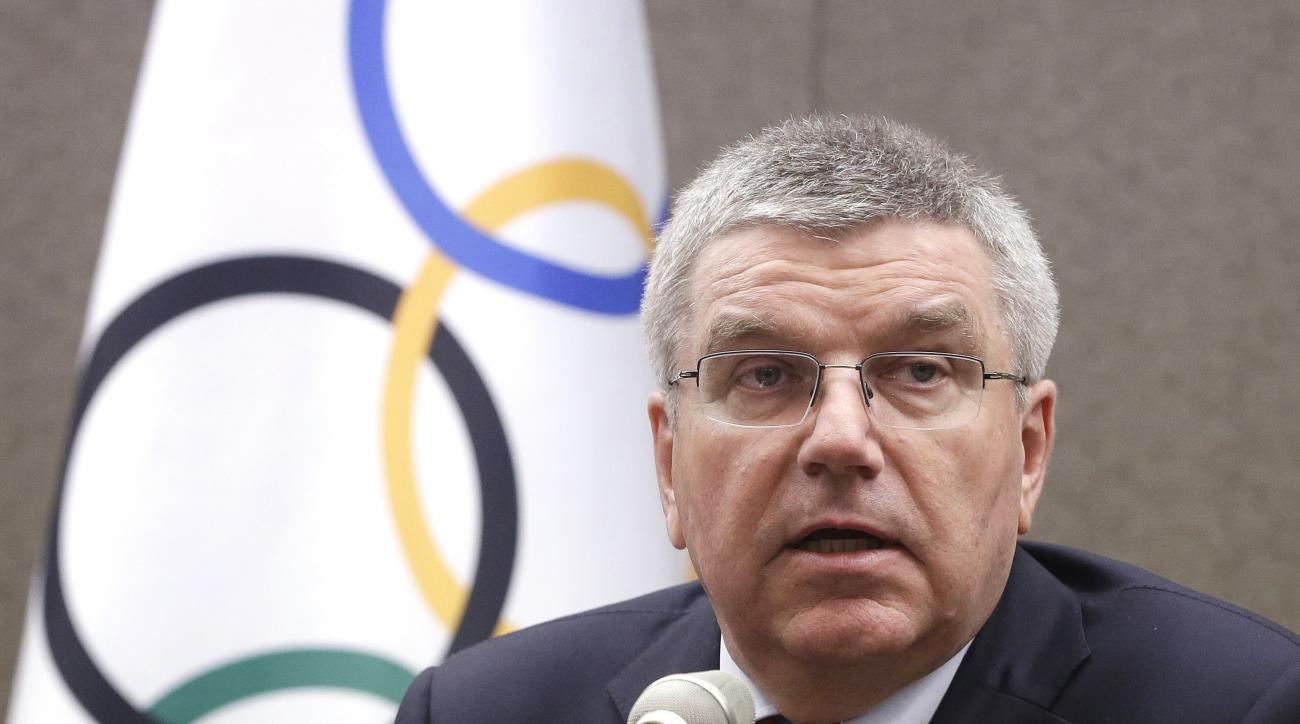 "FILE - In this Wednesday, Aug. 19, 2015 file photo, International Olympic Committee (IOC) President Thomas Bach speaks during a press conference in Seoul, South Korea. IOC President Thomas Bach says international Olympic officials will try to find ""the ri"