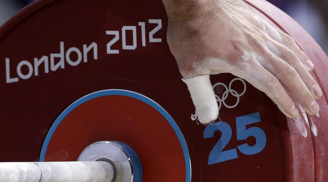 Oleksiy Torokhtiy of Ukraine prepares to attempt a lift during men's 105-kg, group A, weightlifting competition at the 2012 Summer Olympics, Monday, Aug. 6, 2012, in London. (AP Photo/Hassan Ammar)