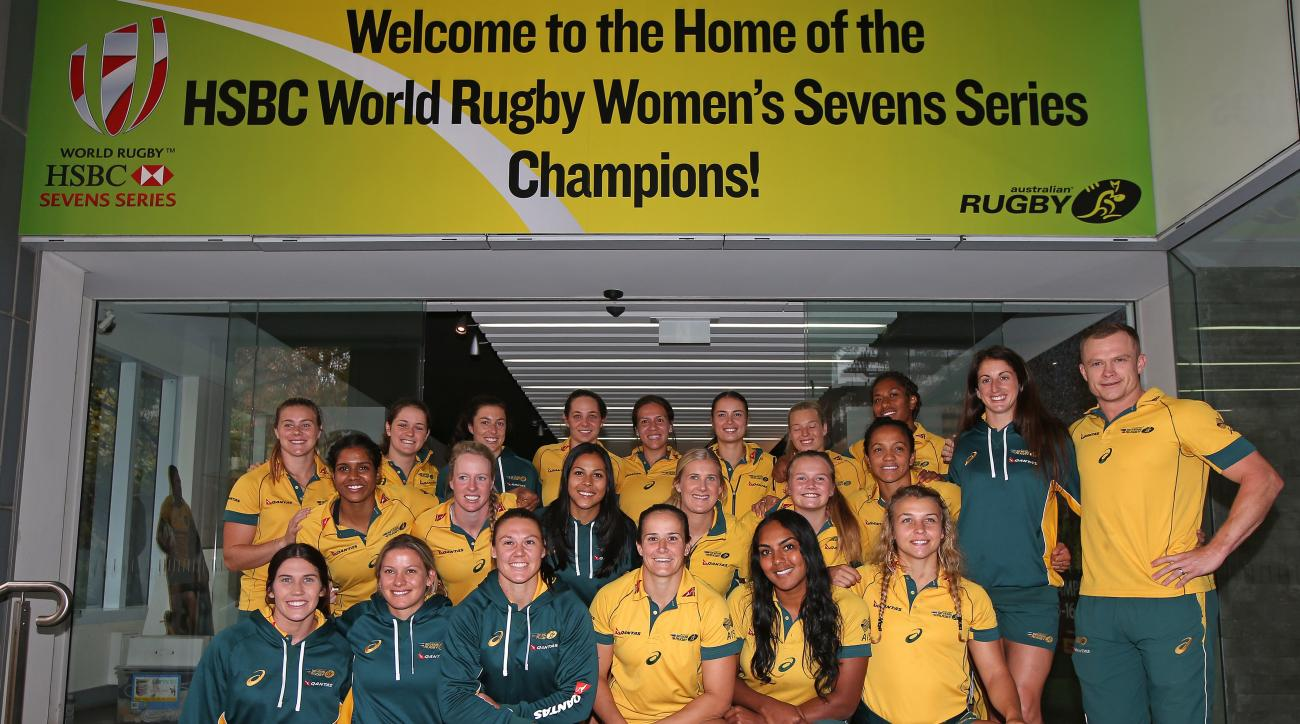 In this June 1, 2016, photo the Australia women's rugby sevens team poses with their world champions trophy in Sydney. The Australian women's team, a mix-and-match ensemble of athletes from other sports, enters the Olympic sevens tournament as world champ
