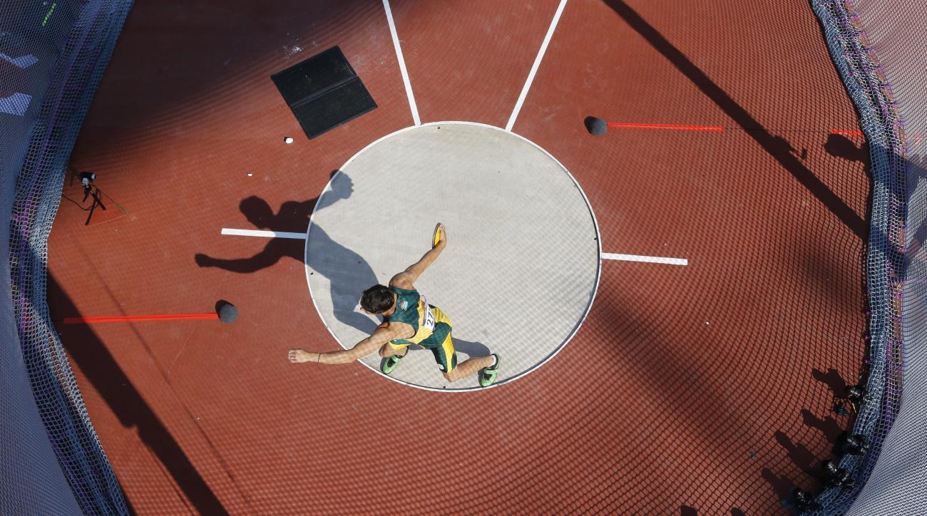 South Africa's Willem Coertzen competes in the men's decathlon discus throw event at the London 2012 Olympic Games at the Olympic Stadium, Thursday, Aug. 9, 2012, in London. (AP Photo/Pawel Kopczynski, Pool)