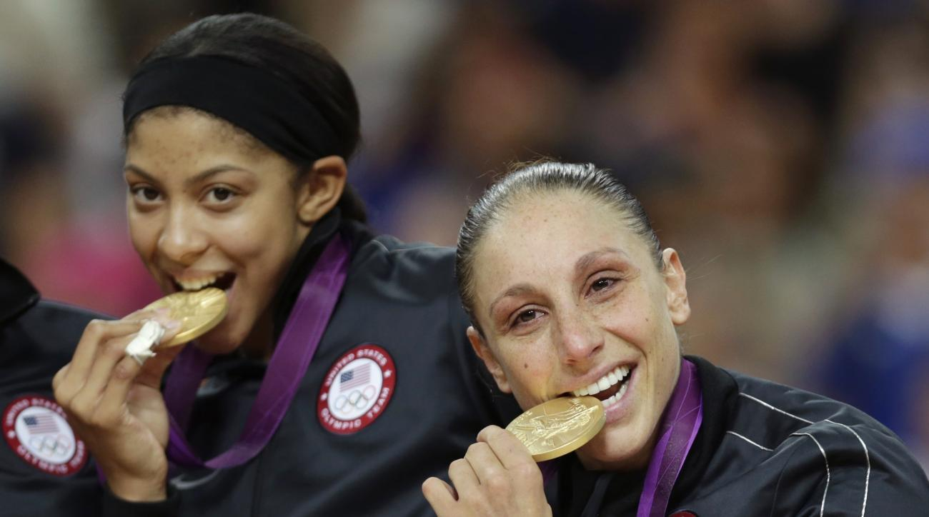 FILE - In this Aug. 11, 2012, file photo, Diana Taurasi, right, and Candace Parker, of the United States, bite their gold medals after beating France in the women's gold medal basketball game at the 2012 Summer Olympics in London. No team has been more do