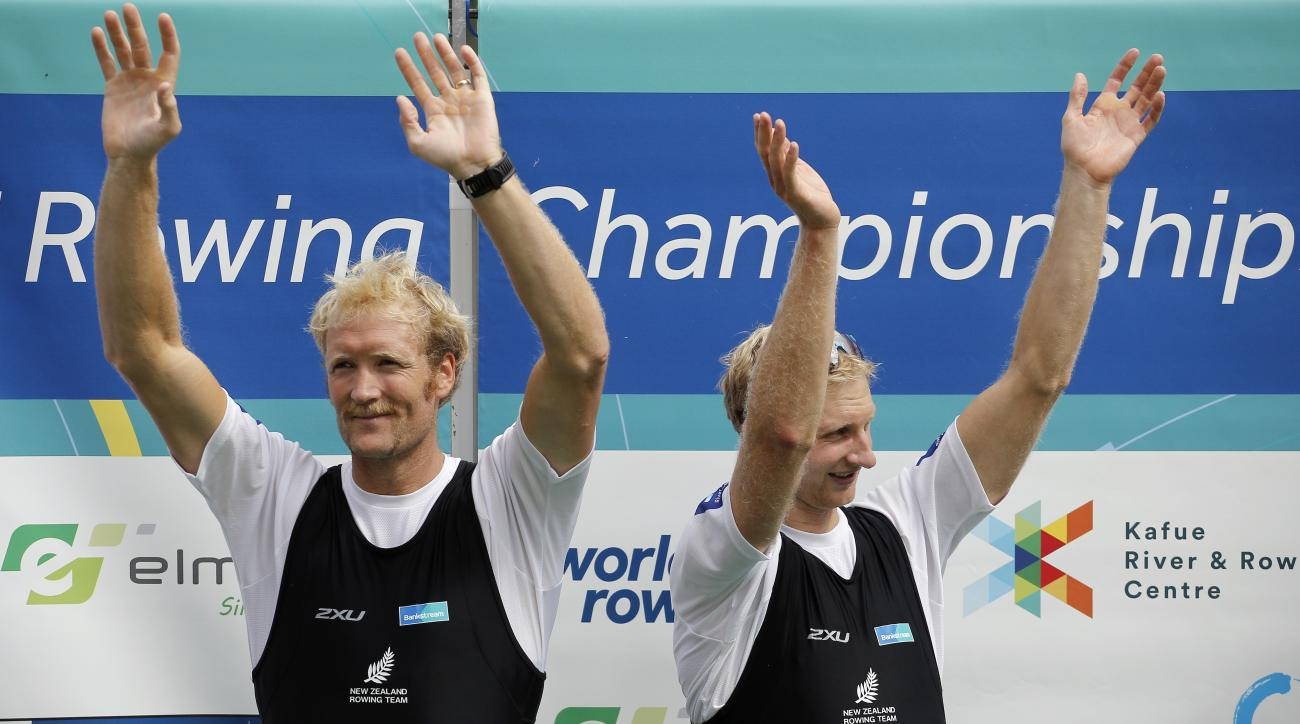 FILE - In this Sept. 5, 2015, file photo, New Zealand's Eric Murray, left, and Hamish Bond, right, celebrate on the podium after winning the Men's Pair during the World Rowing Championships in Aiguebelette, France. When Murray and Bond jump into their boa