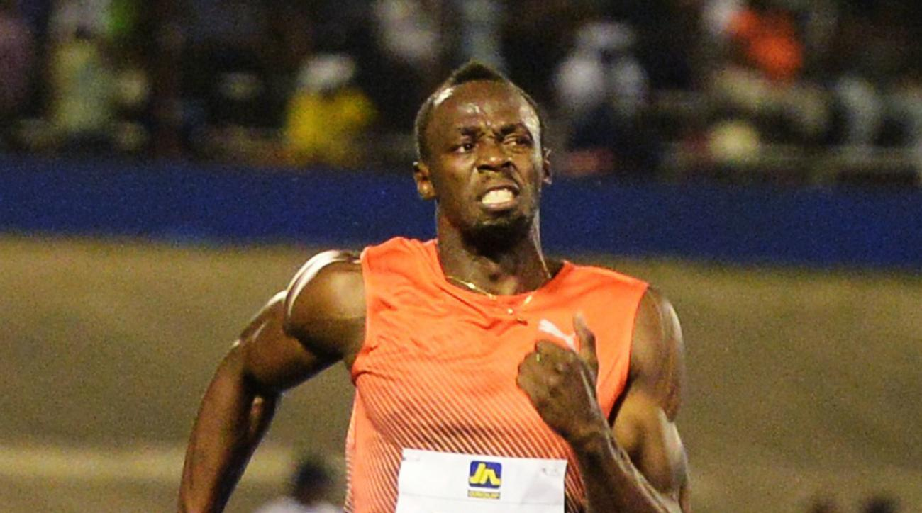 FILE - In this June 11, 2016, file photo, Usain Bolt, of Jamaica, wins the 100-meter final ahead of Yohan Blake and Asafa Powell, both of Jamaica, in the Racers Grand Prix track and field event at the National Stadium in Kingston, Jamaica. Even if fully f