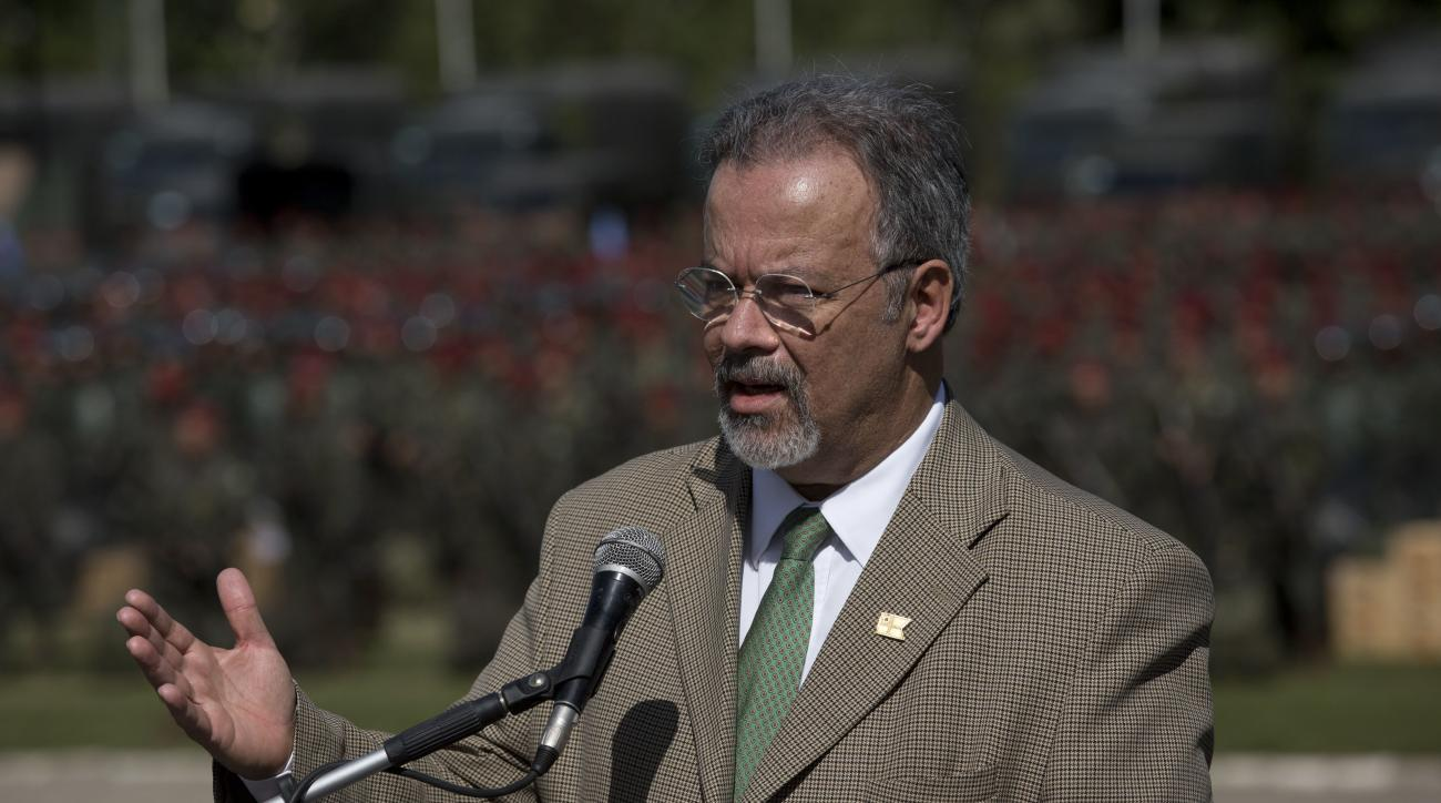 Defense Minister Raul Jungmann speaks during a ceremony to present soldiers who will be deployed during the Olympic games in Rio de Janeiro, Brazil, Friday, July 8, 2016. Roughly twice the security contingent at the London Olympics will be deployed during