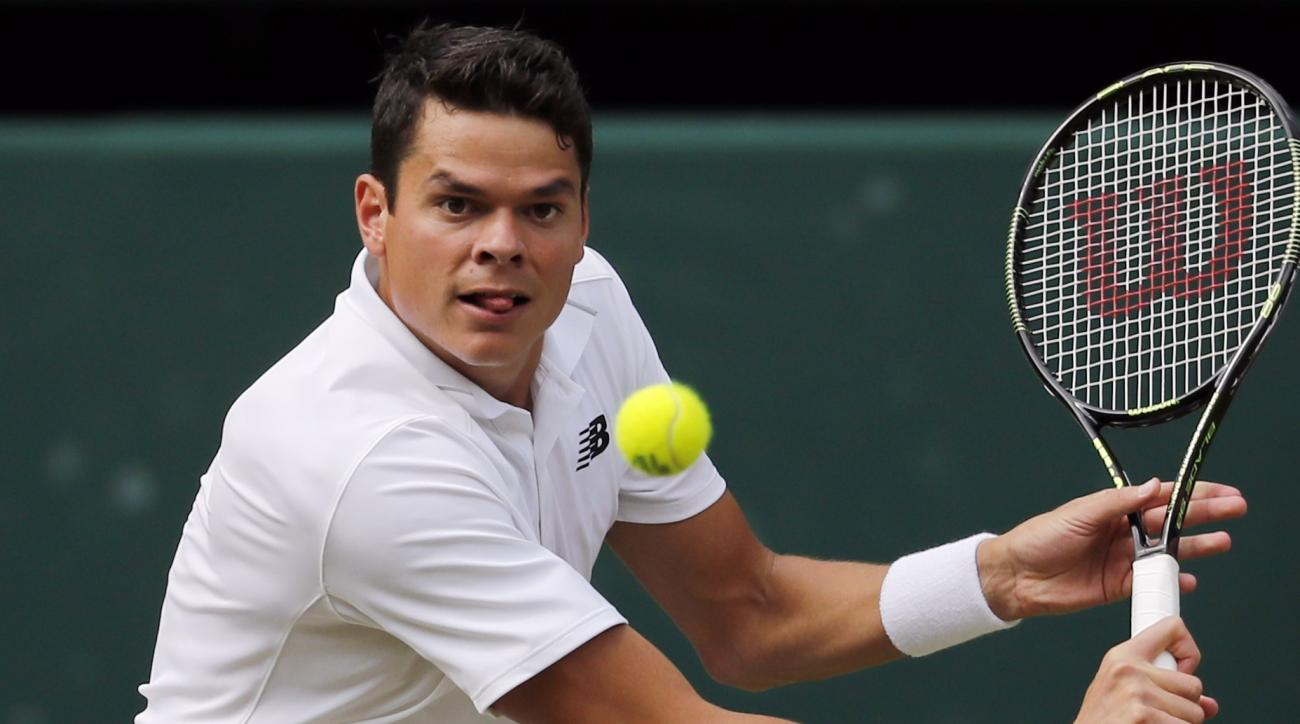 Milos Raonic of Canada plays a return to Andy Murray of Britain during the men's singles final on the fourteenth day of the Wimbledon Tennis Championships in London, Sunday, July 10, 2016. (AP Photo/Ben Curtis)