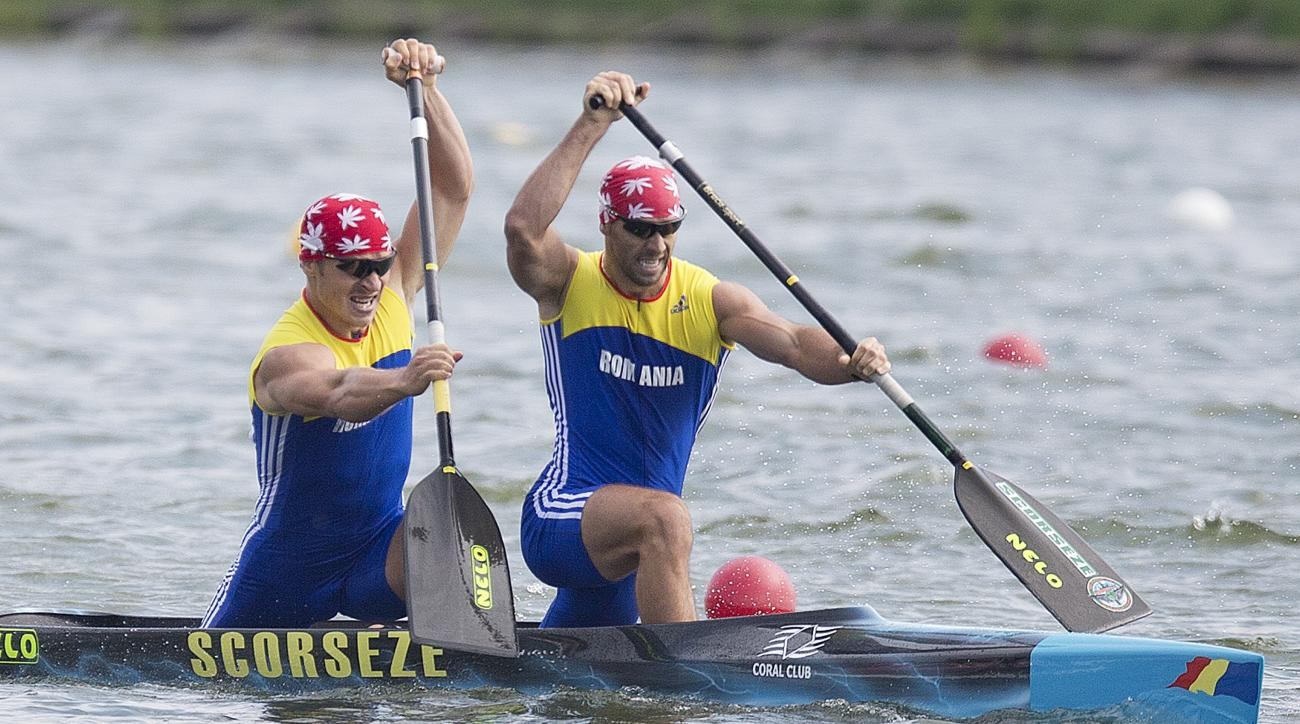 Winners Liviu Alexandru Dumitrescu, right, and Victor Mihalachi of Romania compete at the C2 men 1000m final of the ICF Canoe Sprint World Championships 2014 in Moscow, Russia, Sunday, Aug. 10, 2014.  (AP Photo/Pavel Golovkin)