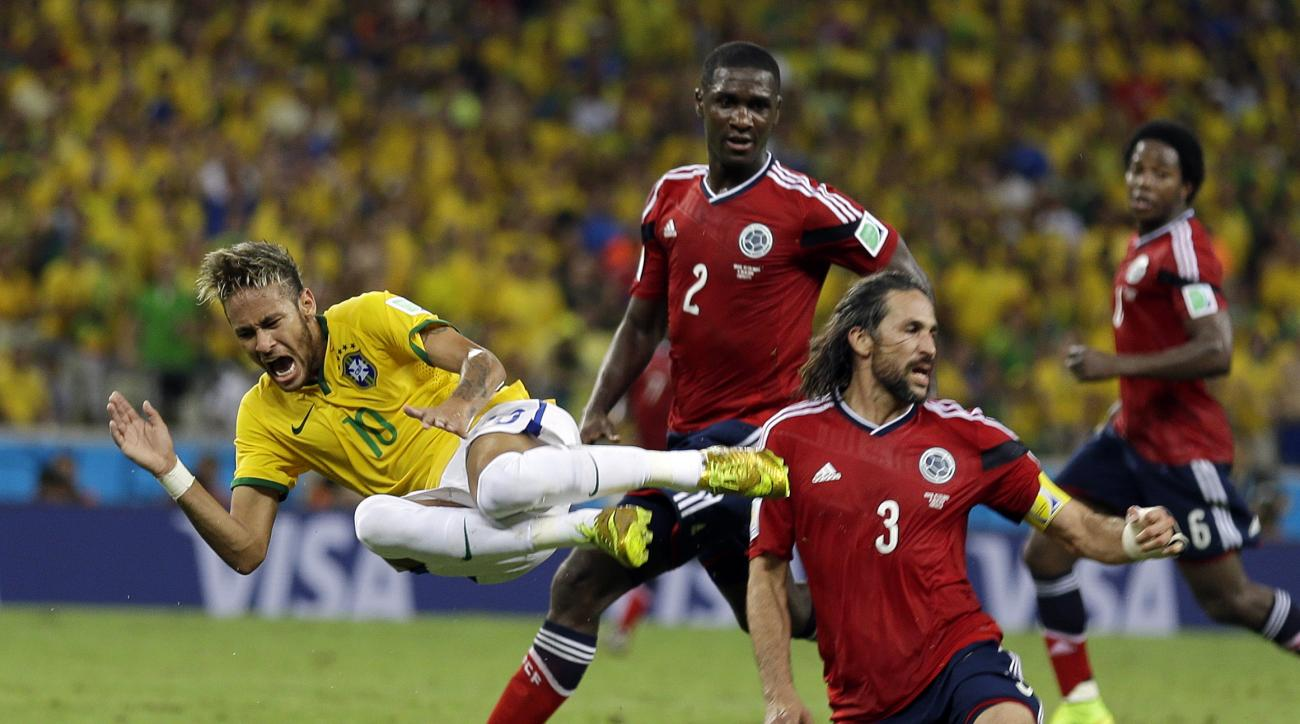FILE - In this July 4, 2014 file photo, Brazil's Neymar is airborne after running into Colombia's Mario Yepes during the World Cup quarterfinal soccer match in Fortaleza, Brazil. All eyes will be on the 24-year-old striker during the Rio 2016 Olympics, wh