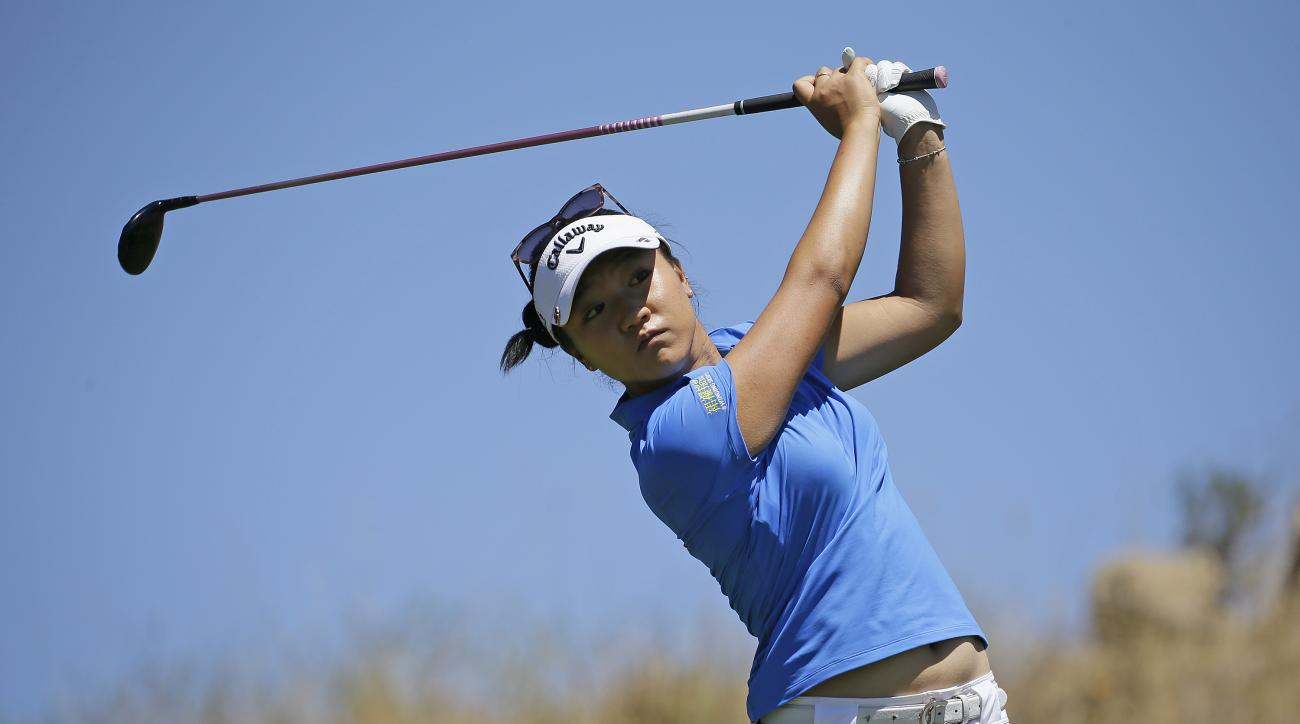 Lydia Ko, of New Zealand, follows her shot from the sixth tee during the third round of the U.S. Women's Open golf tournament at CordeValle Saturday, July 9, 2016, in San Martin, Calif. (AP Photo/Eric Risberg)