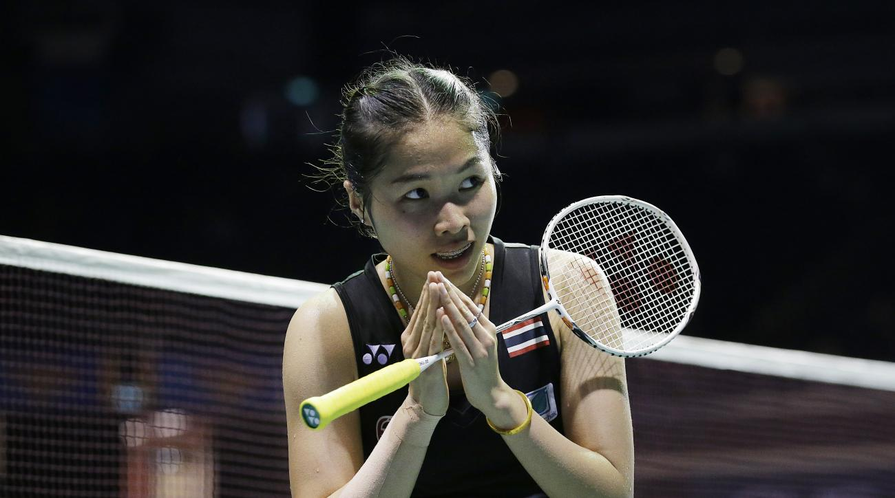 Intanon Ratchanok of Thailand greets the audience after beating Akane Yamaguchi of Japan during their women's singles semi-final match at the Singapore Open Badminton championship on Saturday, April 16, 2016, in Singapore. (AP Photo/Wong Maye-E)