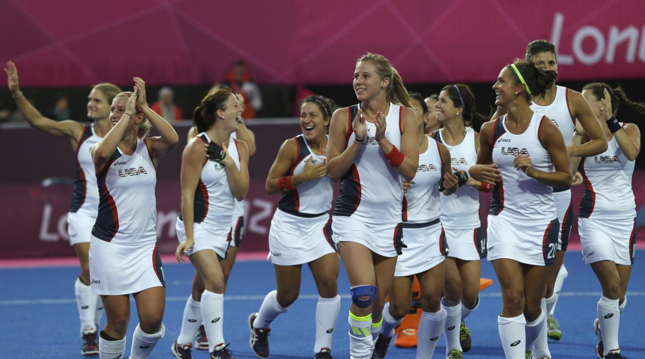 FILE - In this July 31, 2012 file photo, members of the United States' women's hockey team cheer the crowd following their 1-0 victory over Argentina in their women's hockey preliminary match at the 2012 Summer Olympics, in London. The United States is a