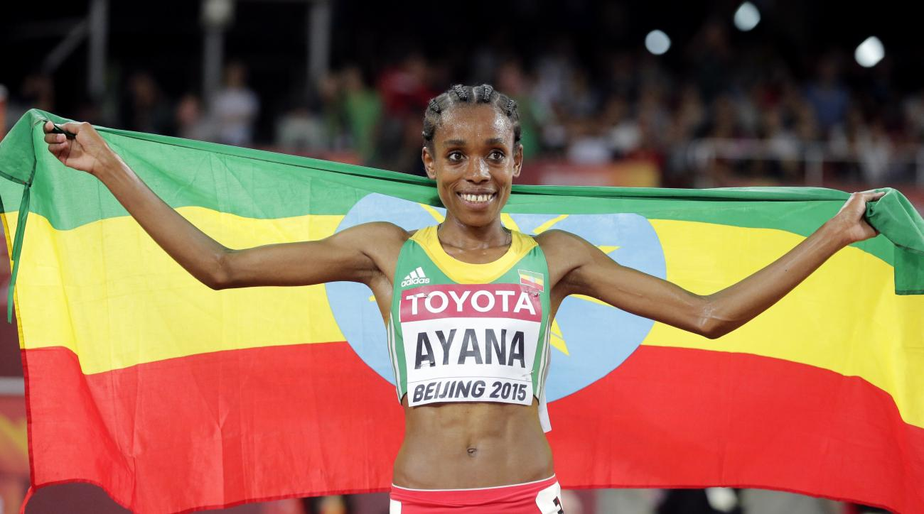 FILE - In this Sunday Aug. 30, 2015 file photo, Ethiopia's Almaz Ayana celebrates after winning the gold in the women's 5000m in a championship record time of 14:26.83 at the World Athletics Championships at the Bird's Nest stadium in Beijing, 2015. Almaz