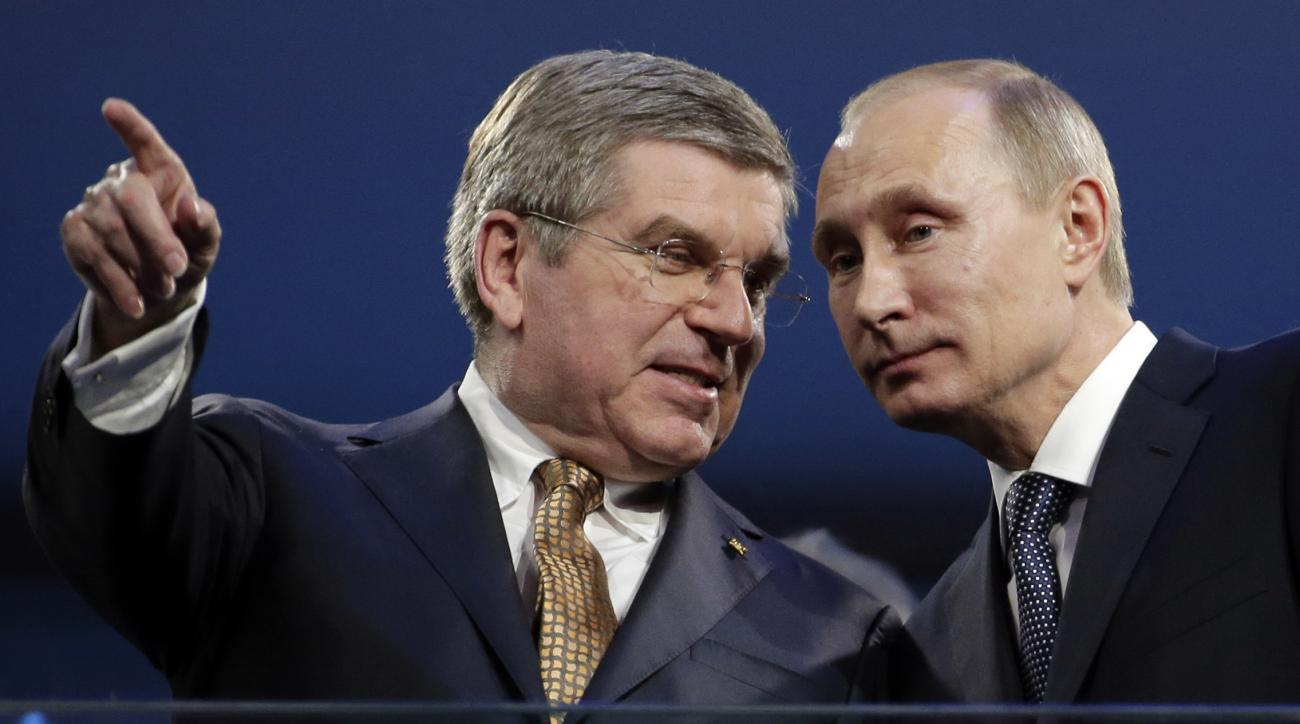FILE - In this Feb. 23, 2014 file photo International Olympic Committee President Thomas Bach, left, and Russian President Vladimir Putin watch the closing ceremony of the 2014 Winter Olympics in Sochi, Russia. The executive board of the International Oly