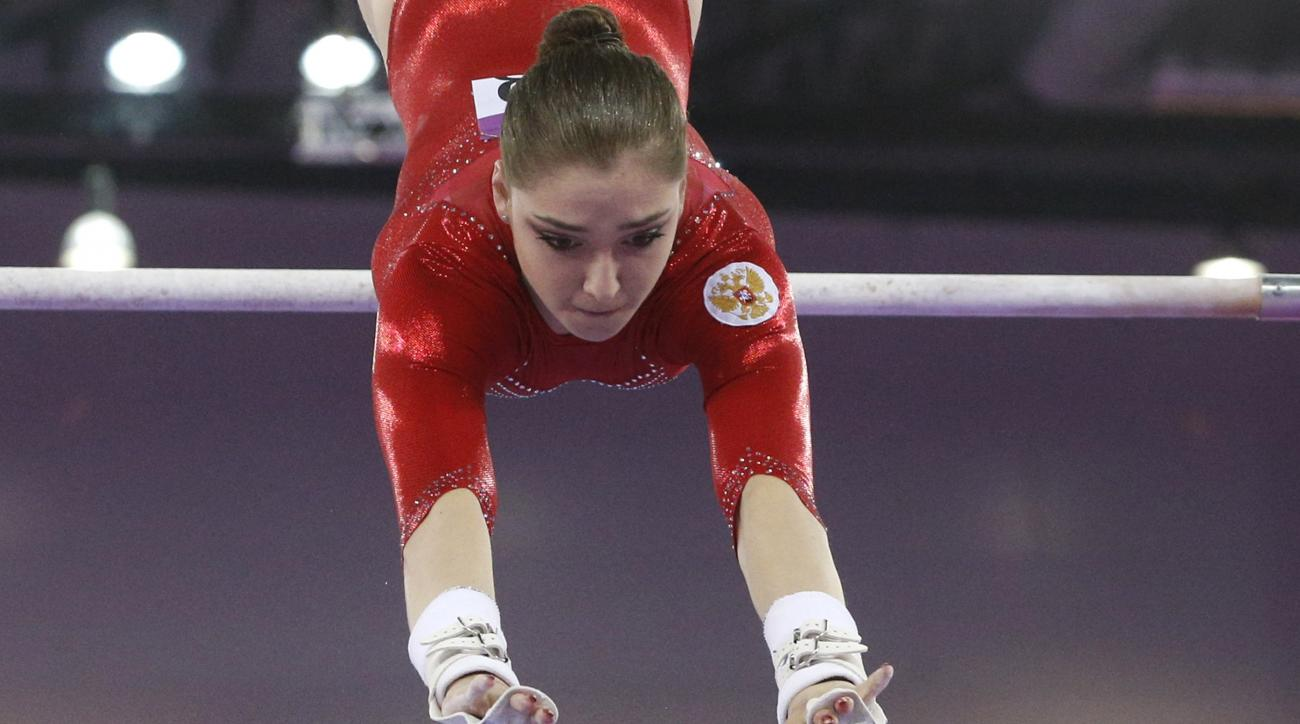 Aliya Mustafina of Russia competes during final of the women's uneven bars event at the 2015 European Games in Baku, Azerbaijan, Saturday, June 20, 2015. (AP Photo/Dmitry Lovetsky)
