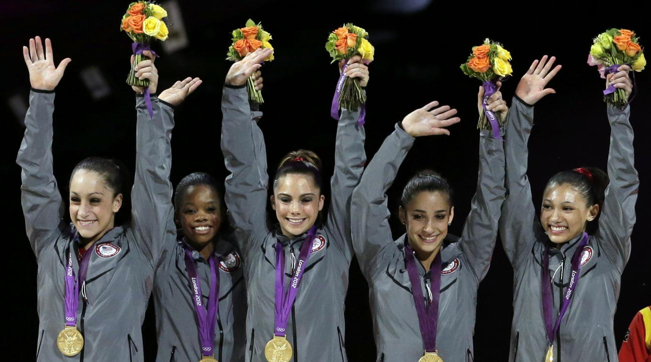 FILE - In this July 31, 2012, file photo, U.S. gold medal gymnasts, left to right, Jordyn Wieber, Gabrielle Douglas, McKayla Maroney, Alexandra Raisman and Kyla Ross raise their hands on the podium during the medal ceremony for the Artistic Gymnastic wome