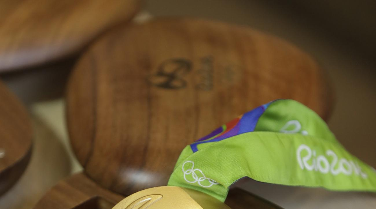 A Rio 2016 Olympic gold medal is displayed at the Olympic Park Wednesday, July 20, 2016, in Rio de Janeiro. There's no such thing as a gold medal, not at these upcoming Rio Olympics, and really, not ever. Second-place finishers get silver medals and oddly