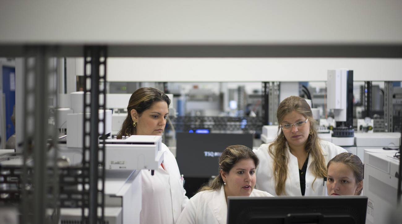 Lab technicians work at the Brazilian Doping Control Laboratory (LBCD) before a visit by Brazil's sports minister in Rio de Janeiro, Brazil, Friday, May 8, 2015. The World Anti-Doping Agency (WADA) will decide on May 13 if LBCD is accredited for Biologica
