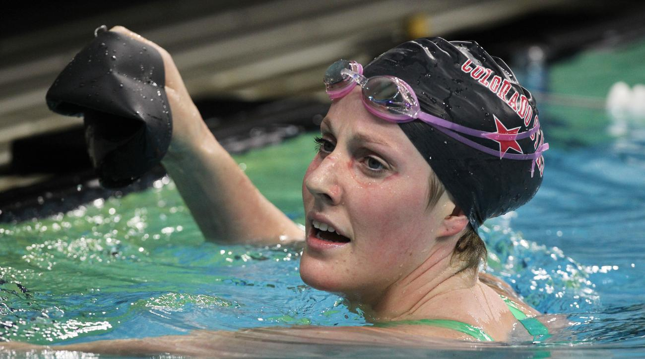 FILE - In this Jan. 16, 2016, file photo, Missy Franklin watches the results board of the women's 200-meter backstroke during the Arena Pro Swim Series, in Austin, Texas. Missy Franklin and Ryan Lochte will be busy in the pool at the Rio Olympics. Just no