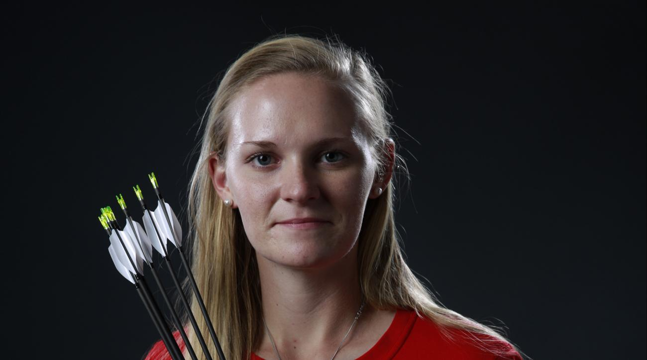 FILE - In this March 9, 2016, file photo, Olympic archer Mackenzie Brown poses for photos at the 2016 Team USA Media Summit in Beverly Hills, Calif. Mackenzie Brown: She knits, line dances, target shoots while listening to music _ usually country stars li