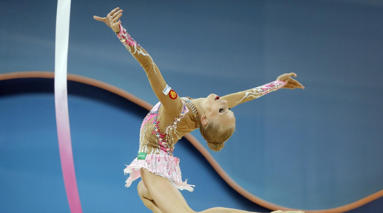 FILE - In this Aug. 29, 2013, file photo, Yana Kudryavtseva, of Russia, performs with ribbon during the 32nd rhythmic gymnastics world championships in Kiev, Ukraine. Russia is known for its quick tempo and intricate, crowd-pleasing routines in rhythmic g