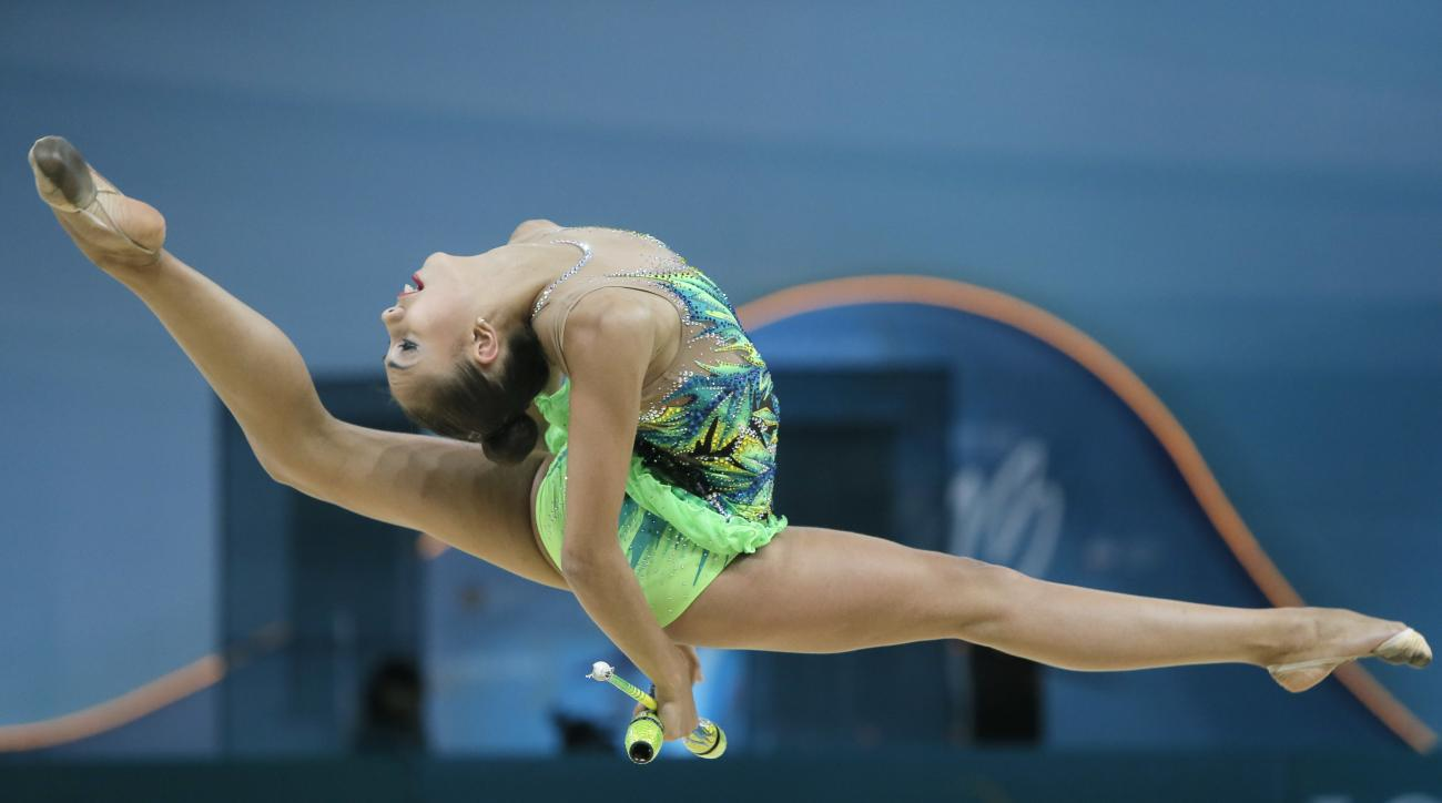 FILE - In this Aug. 29, 2013, file photo, Margarita Mamun of Russia perform with clubs during the 32nd rhythmic gymnastics world championships in Kiev, Ukraine. Russia is known for its quick tempo and intricate, crowd-pleasing routines in rhythmic gymnast