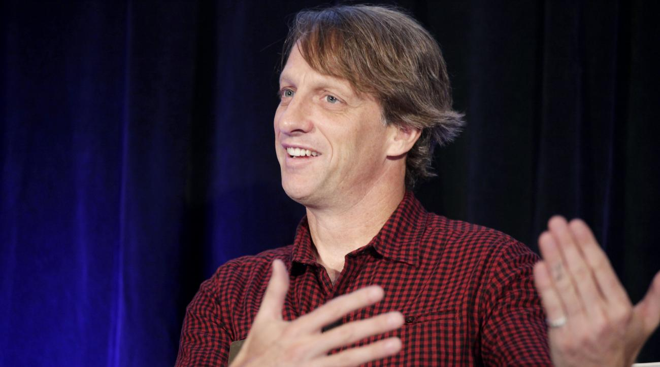 FILE - In this Oct. 4, 2011, file photo, Tony Hawk gestures while speaking at the Executive Marketing Summit in New York. Skateboarding icon Tony Hawk thinks his sport will give the Olympics a big lift if its added to the 2020 Tokyo Games.  There are more