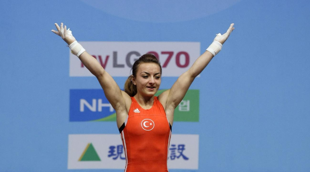 Turkey's Sibel Ozkan reacts in the clean and jerk during the 20th women's group A 48-kilogram category of the World Weightlifting Championships in Goyang, west of Seoul, South Korea, Saturday, Nov. 21, 2009. Sibel won the silver medal scoring total of 206