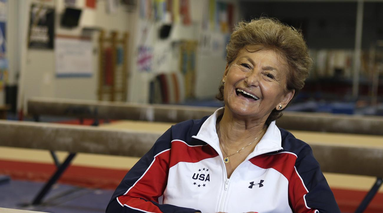 FILE - In this May 4, 2016, file photo, Marta Karolyi smiles inside the Karolyi Ranch where she and her husband, Bela Karolyi, train gymnasts, including members of the Women's National Team, in Houston. After 40 years helping some of the greatest gymnasts