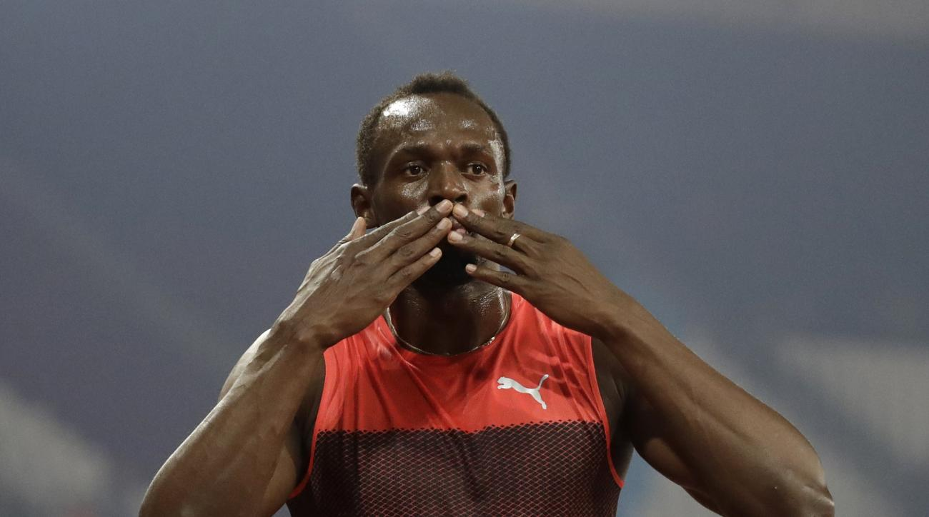 Usain Bolt of Jamaica poses for photographers after he won the men's 200 meter race during the Diamond League anniversary games at The Stadium, in the Queen Elizabeth Olympic Park in London, Friday, July 22, 2016.(AP Photo/Matt Dunham)