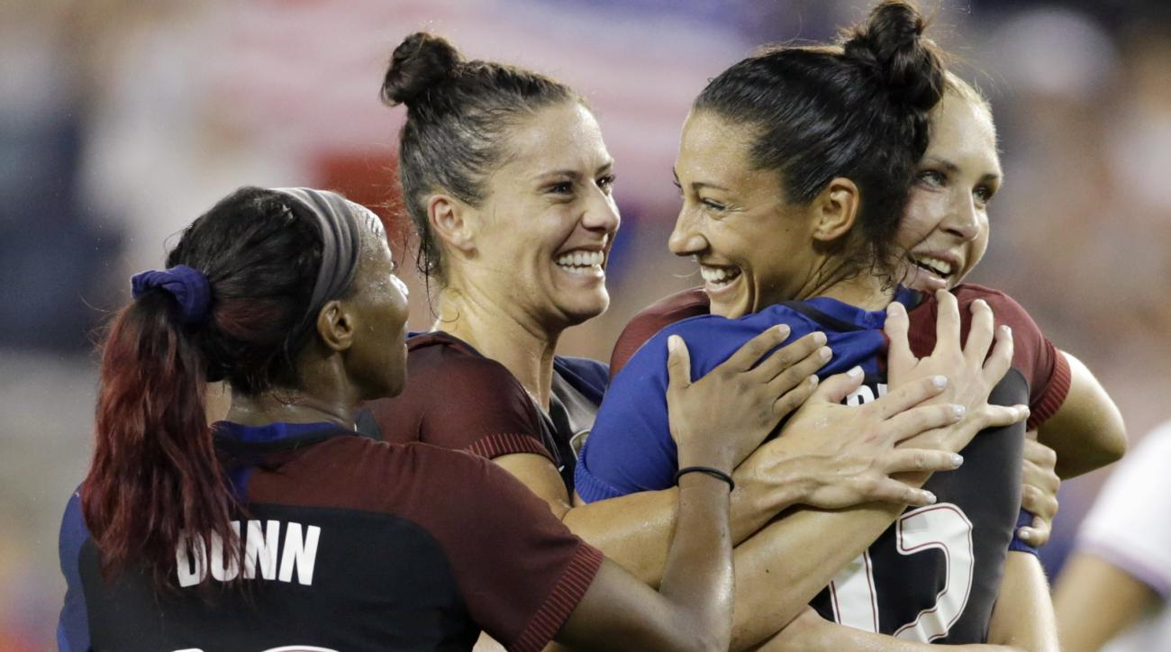 United States forward Christen Press, second from right, is congratulated by Crystal Dunn (16) Kelley O'Hara, second from left, and Allie Long, right, after scoring against Costa Rica in the second half of women's international friendly soccer match, Frid