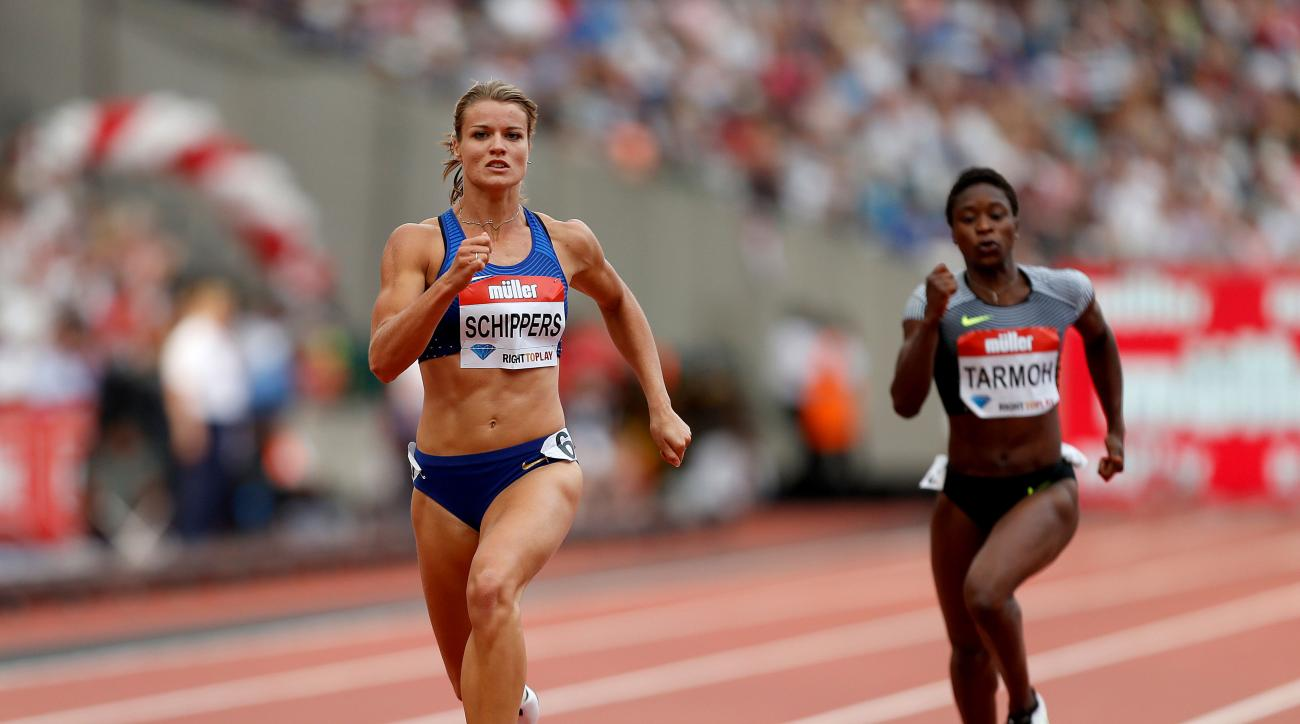 Netherland's Dafne Schippers, left, during day 2 of the Diamond League anniversary games at The Stadium, in the Queen Elizabeth Olympic Park in London, Saturday July 23, 2016. (Paul Harding/PA via AP)