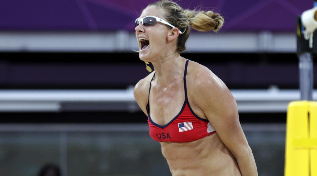 FILE- In this Aug. 7, 2012, file photo, Kerri Walsh Jennings of the United States leaps in the air after beating China in two sets during a women's semi-final beach volleyball match at the 2012 Summer Olympics. A new film about the three-time Olympic gold
