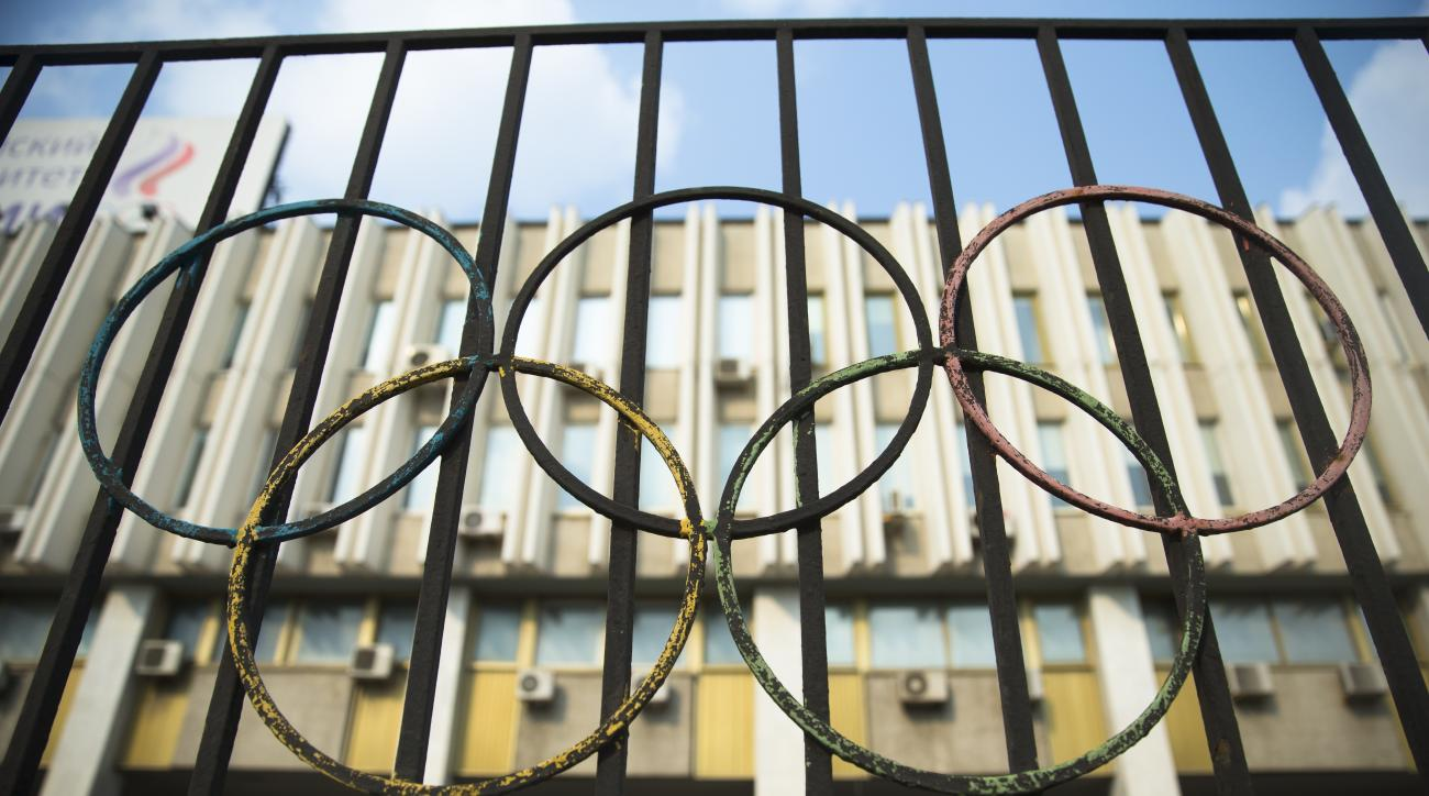The Olympics rings are seen on a fence in front of the Russian Olympic Committee building in Moscow, Russia, Sunday, July 24, 2016. The IOC has decided against a complete ban on Russian athletes from the Olympics in Rio de Janeiro. The International Olymp