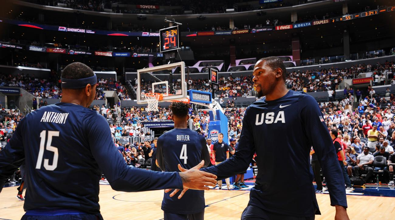 LOS ANGELES, CA - JULY 24:  Carmelo Anthony #15 of the USA Basketball Men's National Team and Kevin Durant #5 of the USA Basketball Men's National Team shake hands during the game against China on July 24, 2016 at STAPLES Center in Los Angeles, California