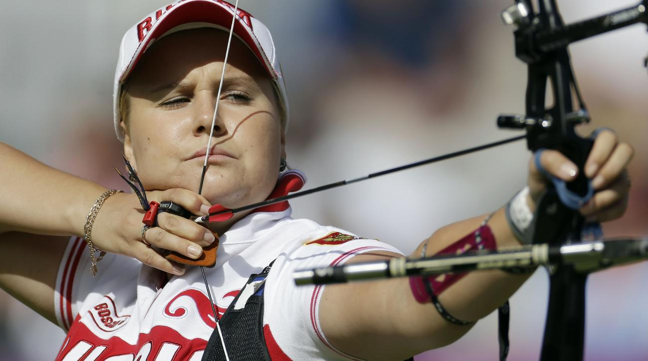 Russia's Ksenia Perova shoots during the individual archery competition at the 2012 Summer Olympics, Thursday, Aug. 2, 2012, in London. (AP Photo/Marcio Jose Sanchez)