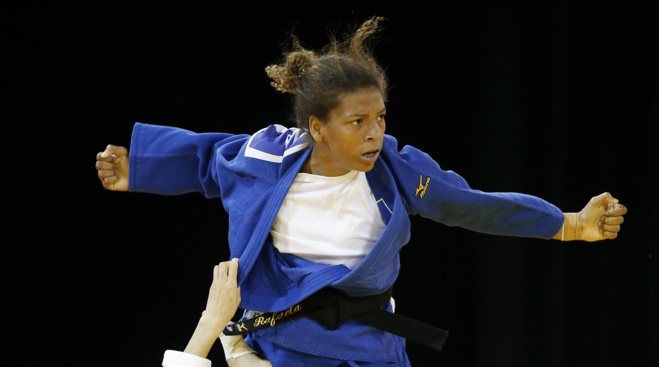 FILE - In this July 12, 2015 file photo, Brazil's Rafaela Silva, top, competes against Venezuela's Anriquelis Barrios during a women's -57kg bronze medal judo match at the Pan Am Games, in Mississauga, Ontario. Silva hoped to get an Olympic gold medal fou