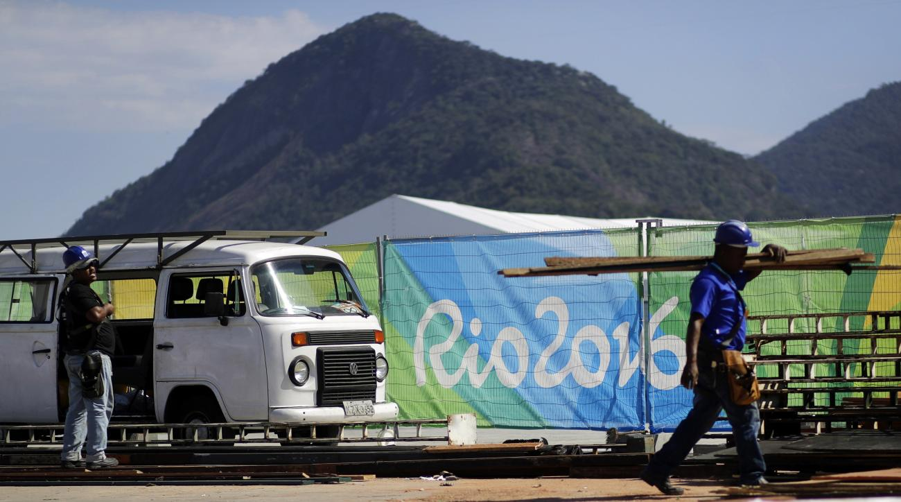 Construction workers take part in preparations for the 2016 Rio de Janeiro Games inside Olympic Park in Rio de Janeiro, Brazil, Wednesday, July 27, 2016. (AP Photo/Patrick Semansky)