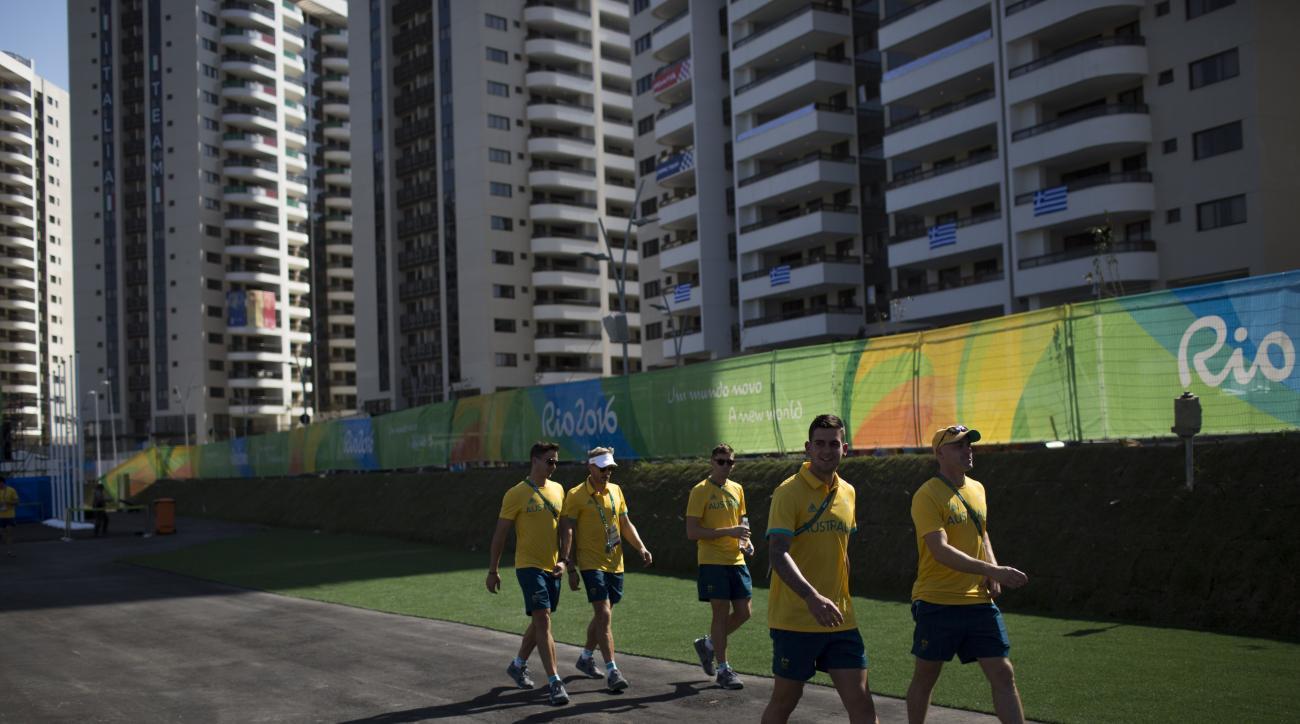 Members of the Australian hockey team walk at the Olympic Village after a ceremony with Rio's mayor in Rio de Janeiro, Brazil, Wednesday, July 27, 2016. (AP Photo/Felipe Dana)