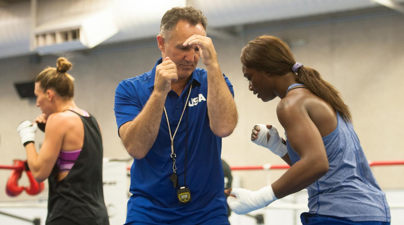 FILE - In this Friday, July 15, 2016, file photo, Claressa Shields, right, trains with women's Olympic team coach Billy Walsh at the U.S. Olympic Training Center Colorado Springs, Colo. Coach Billy Walsh brought a lifetime of amateur boxing experience fro