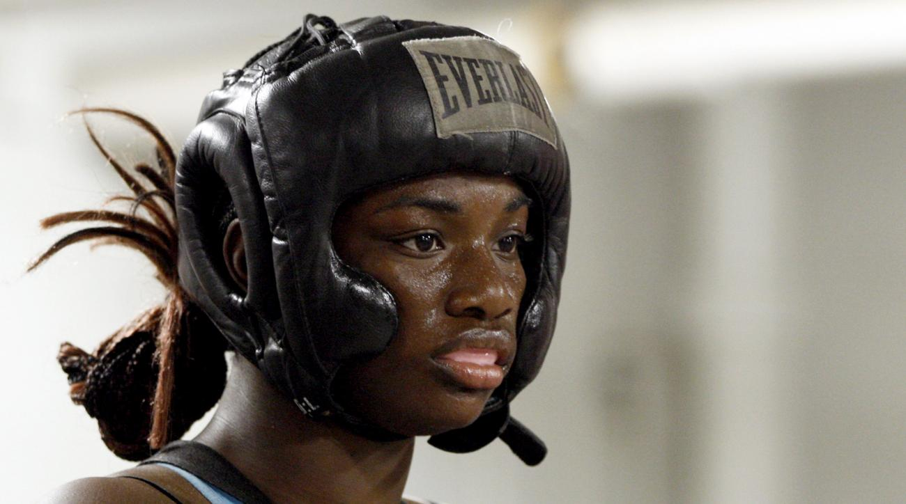 In this Sept. 18, 2012, photo, Olympic gold medal boxer Claressa Shields trains at the Berston Field House in Flint, Mich. Aside from her Olympic title and a jab that could knock someone out cold, Shields isn't much different than other high school senior