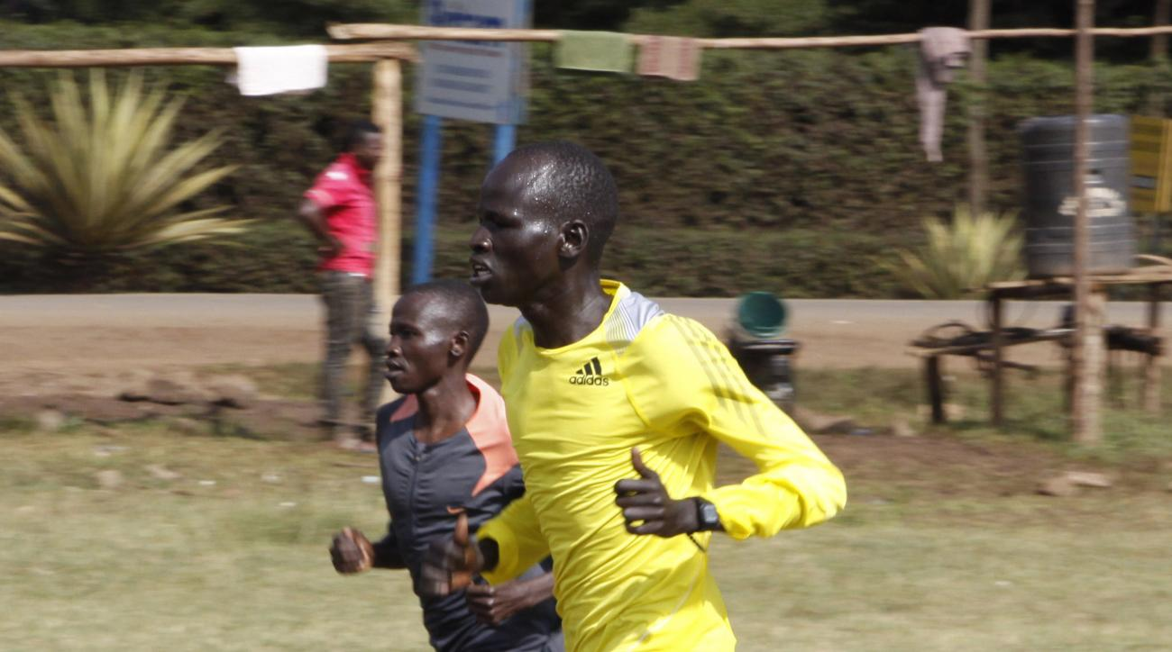 In this photo taken Thursday, June 30, 2016,  Yiech Pur Biel trains in Ngong, Kenya.  Yiech is one of five runners from South Sudan that grew up in a refugee camp and are part of the IOC's first refugee team that will be competing at the Rio Olympics.  (A