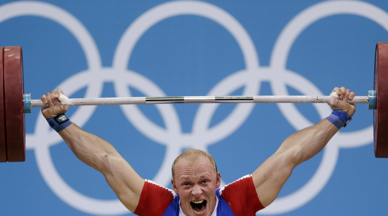 Russia's Andrey Demanov competes during the men's 94-kg weightlifting competition at the 2012 Summer Olympics, Saturday, Aug. 4, 2012, in London. (AP Photo/Mike Groll)