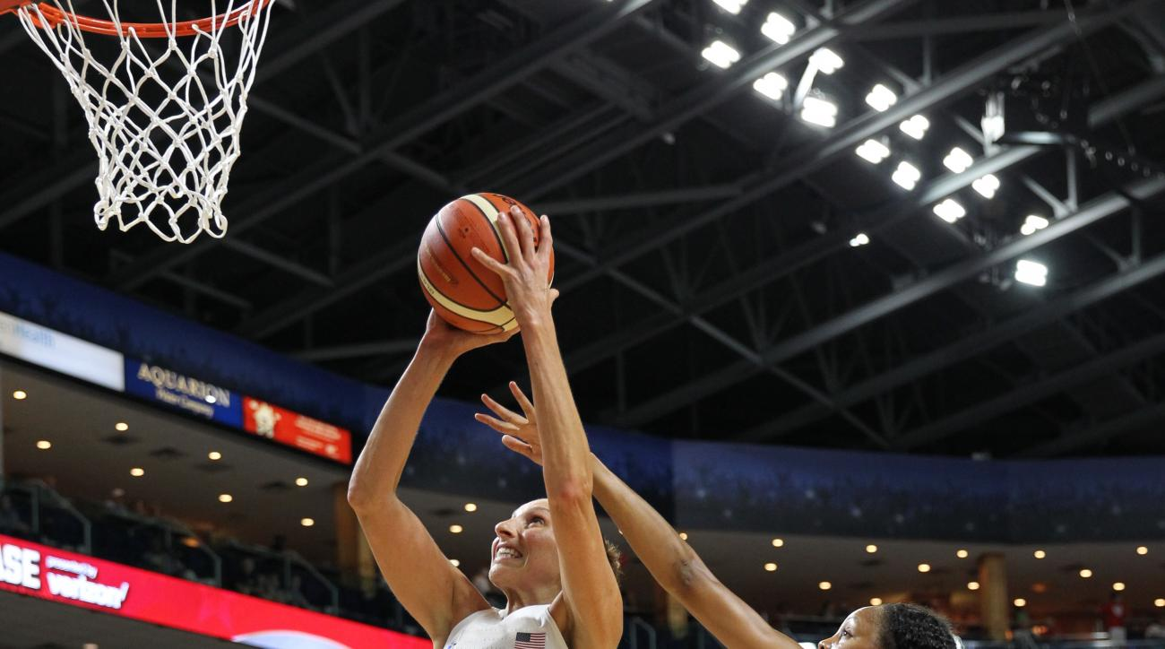 BRIDGEPORT, CT - JULY 29:   Diana Taurasi #12 of the USA Women's National Basketball Team goes to the basket against Nirra Fields #10 of Canada on July 29, 2016 at the Webster Bank Arena in Bridgeport, Connecticut.  (Photo by Chris Marion/NBAE via Getty I