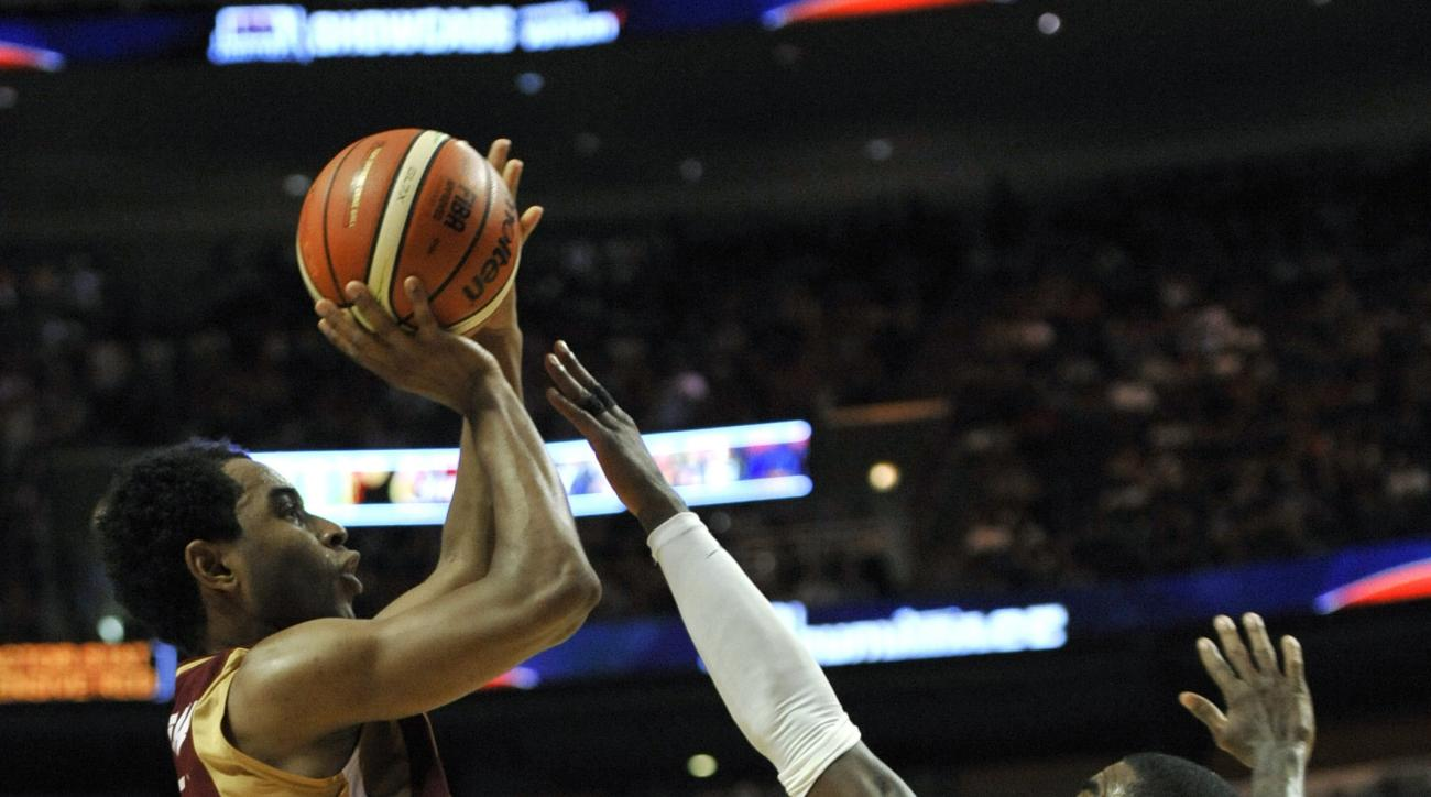 Venezuela's John Cox left, goes up to shoot against USA's Kyrie Irving (10) during the first half of an exhibition basketball game Friday, July 29, 2016, at the United Center in Chicago. (AP Photo/Paul Beaty)