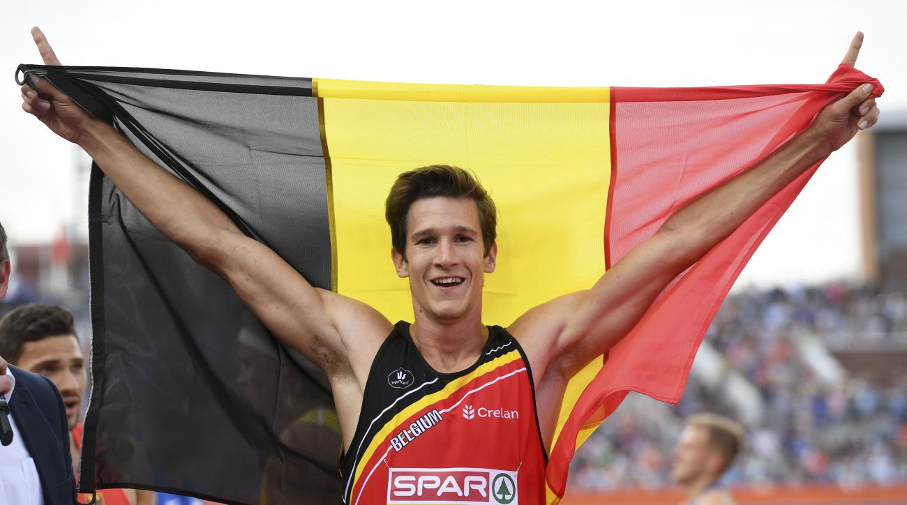 In this Thursday, July 7, 2016 photo, Belgium's Thomas Van Der Plaetsen celebrates after winning the gold medal in the men's Decathlon, at the European Athletics Championships in Amsterdam, the Netherlands.   At his lowest point chemotherapy had turned hi