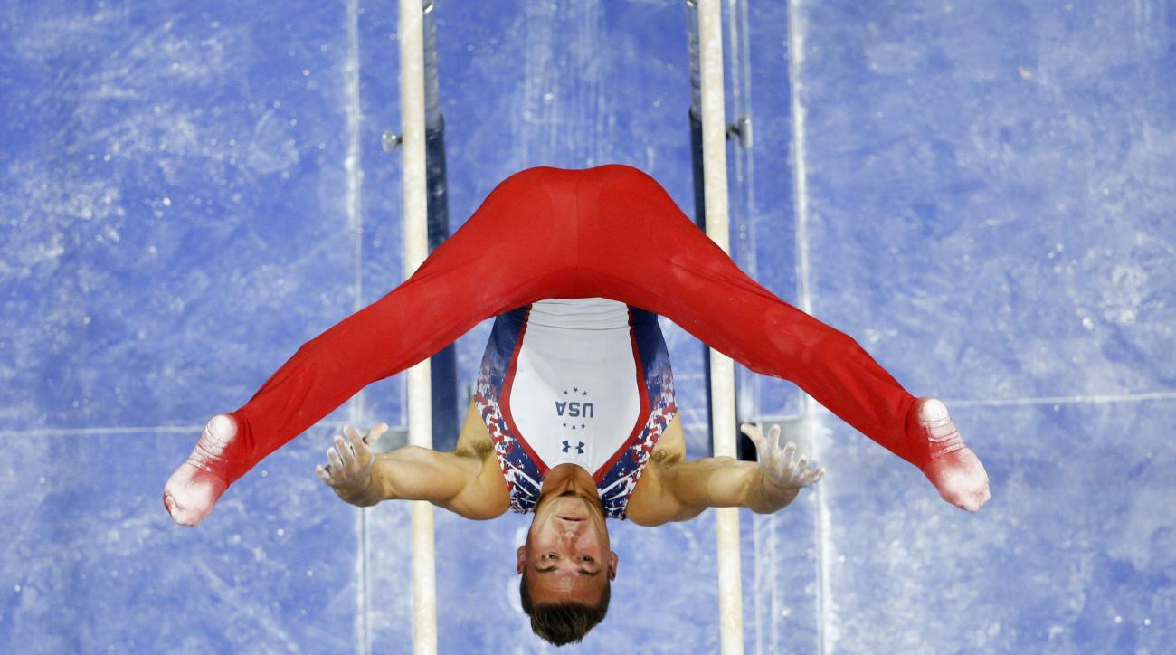 File-This June 25, 2016, file photo shows Sam Mikulak competing on the parallel bars during the U.S men's Olympic gymnastics trials in St. Louis.  Four-time national champion Mikulak is the greatest American male gymnast of his generation but has yet to e