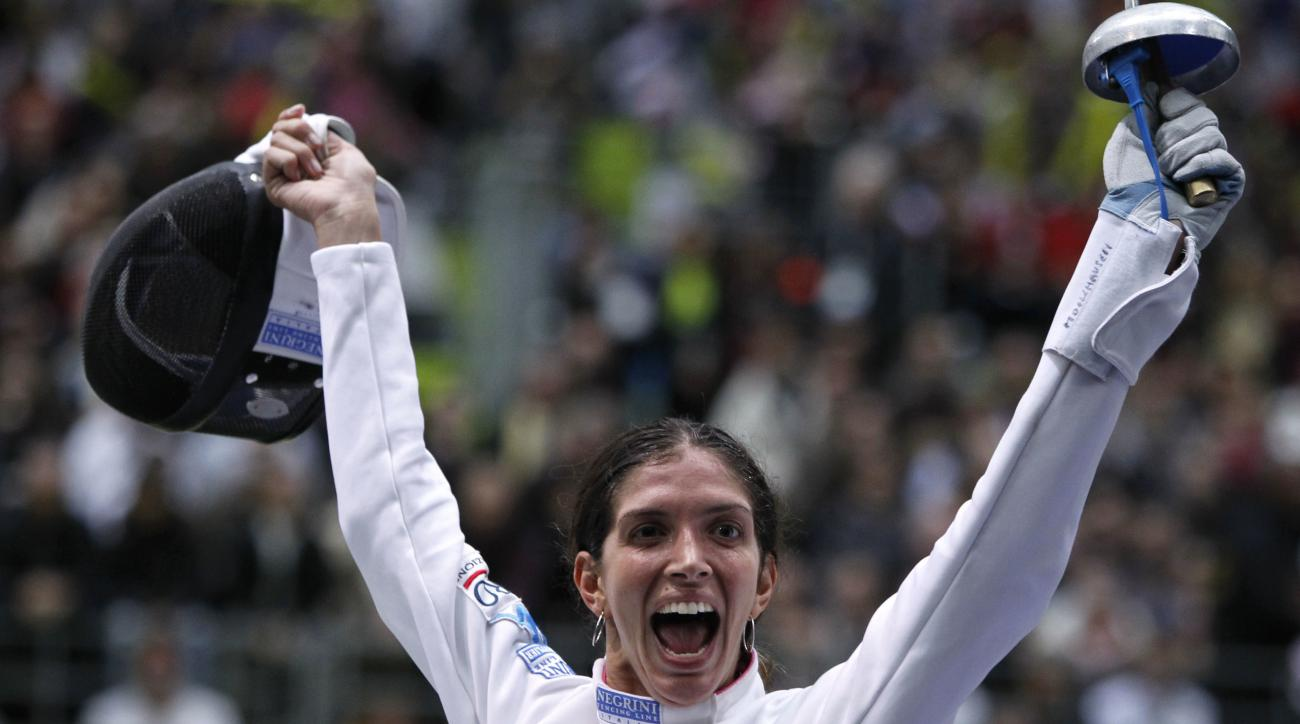 FILE - In this Nov. 8, 2010, file photo, Italy's Nathalie Moellhausen reacts as she defeats Poland's Magdalen Piekarska in a women's single epee quarterfinal during the fencing World Championships in Paris. To fulfill an old dream of her 82-year-old grand