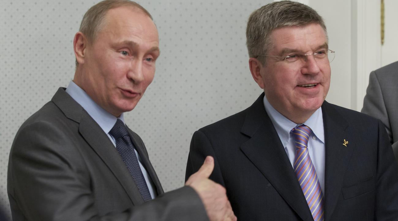 FILE - In this Oct. 28, 2013, file photo, Russian President Vladimir Putin, left, and International Olympic Committee President Thomas Bach meet at the Bocharov Ruchei residence at the Black Sea resort of Sochi, southern Russia. The Olympics have long bee