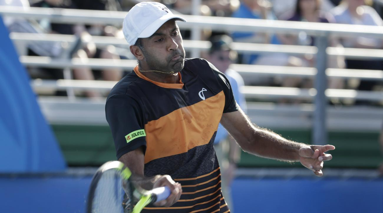 Rajeev Ram hits a return to Sam Querrey during the final of the Delray Beach Open tennis tournament Sunday, Feb. 21, 2016, in Delray Beach, Fla. (AP Photo/Lynne Sladky)