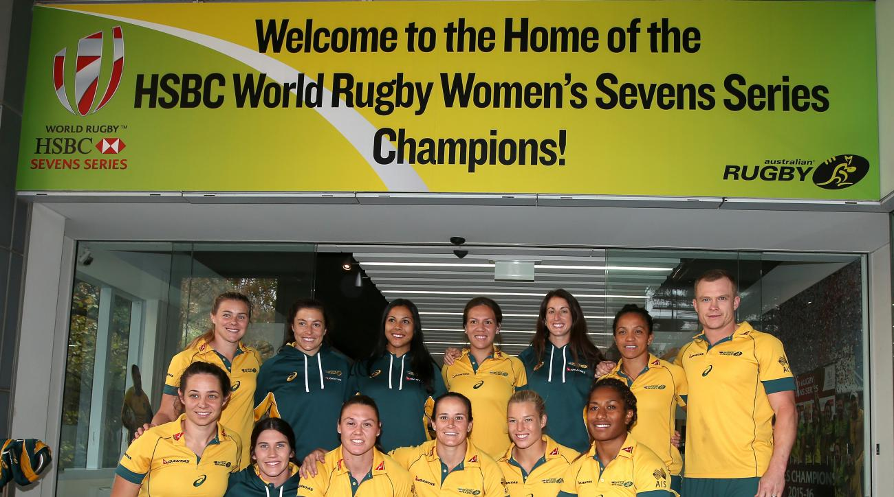 In this June 1, 2016, photo the Australian women's rugby sevens team, including Ellia Green in the front row at right, pose with their World champions trophy in Sydney. The so-called fastest woman in world rugby, for a long time Green trained in track and