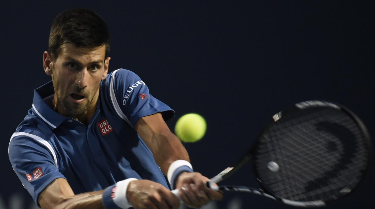 Novak Djokovic, of Serbia, returns the ball to Radek Stepanek, of the Czech Republic, at the Rogers Cup tennis tournament Thursday, July 28, 2016, in Toronto, (Nathan Denette/The Canadian Press via AP)